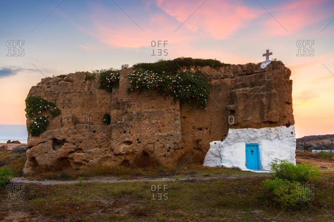 Small church carved into a rock in historical limestone quarry.