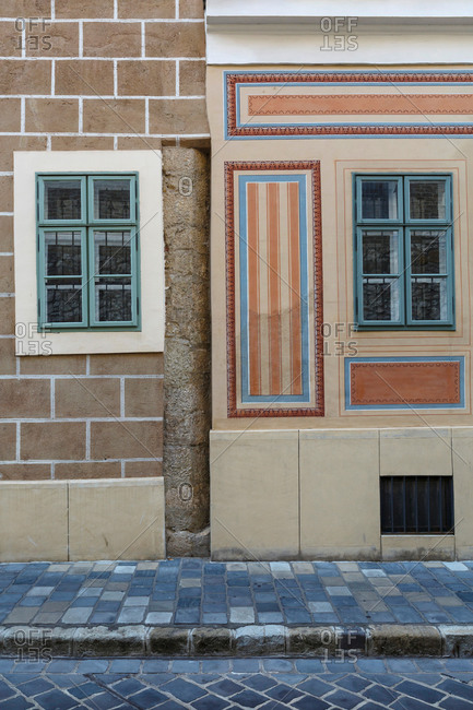 Wall and windows of historical buildings in the old town of Buda.