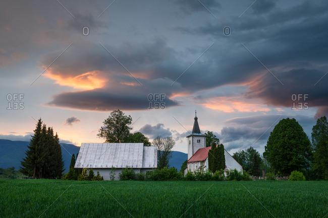 Rural Gothic church in a cemetery near town of Martin.