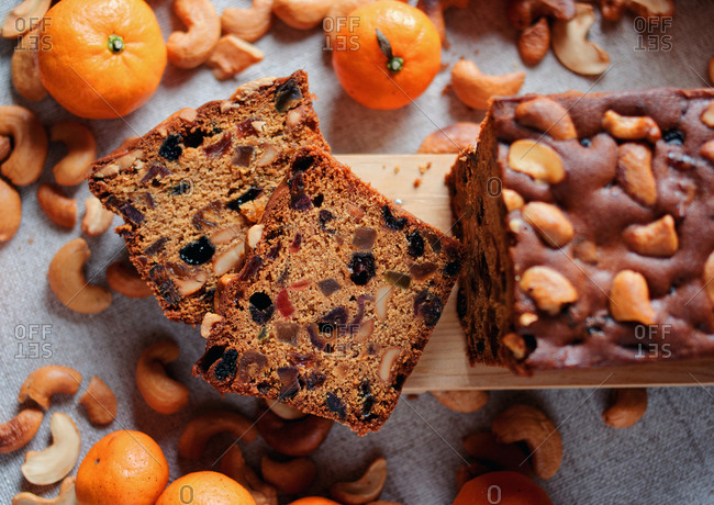 Sliced fruit cake with cashew nuts and oranges