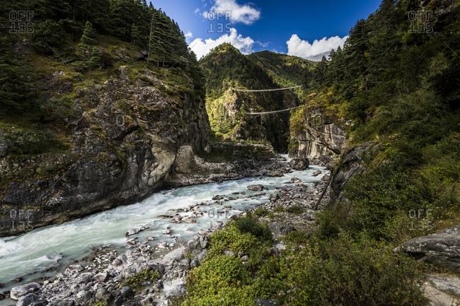 swing bridge over river in the everest region of nepal