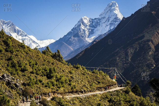 Trekking along the Everest Basecamp trail in Nepal towards Ama Dablam