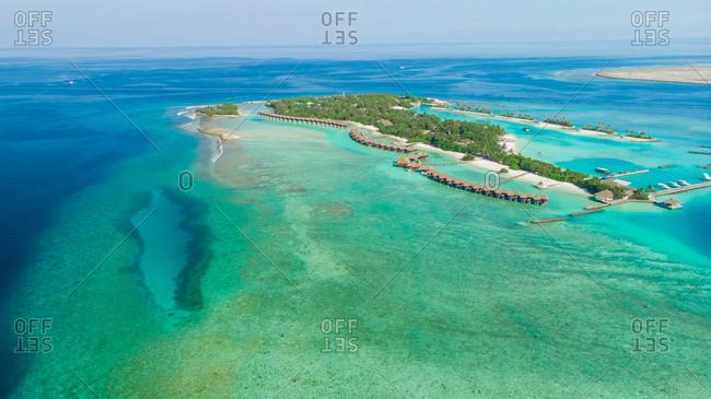 Maldives island with luxury water villas
