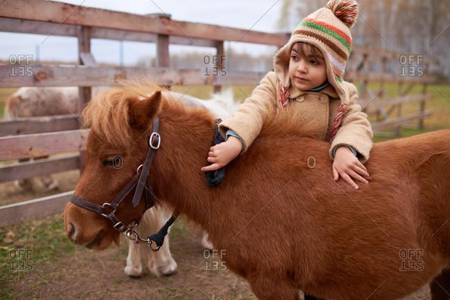 Little Child Spending Time On Horse Farm