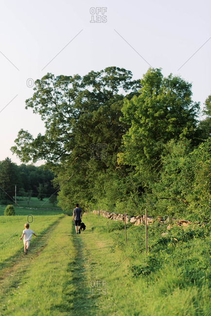 A young family and their dog on a nature walk.