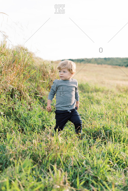 Young boy playing in a field.