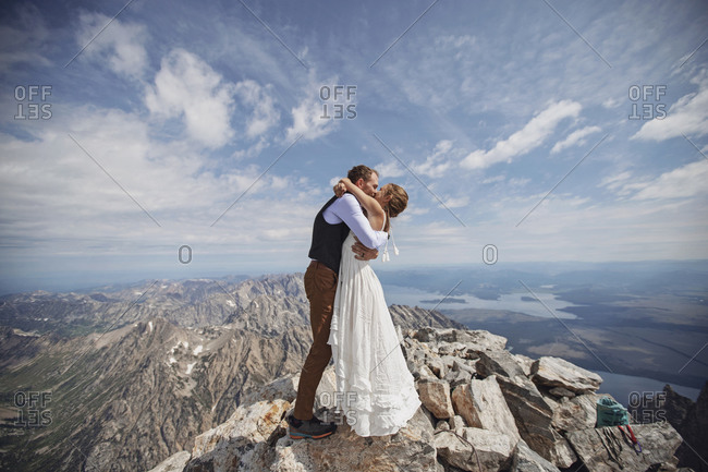 just married couple shares first kiss on summit of Grand Teton Wyoming