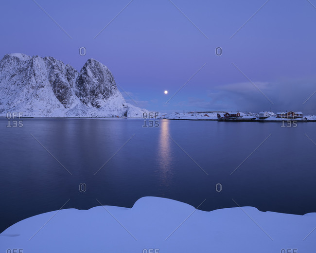 Winter moonrise in pastel twilight over Hamnøy, Moskenesøy, Lofoten Islands, Norway