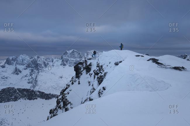Ski tourer on summit of Branntuva, Lofoten Islands, Norway