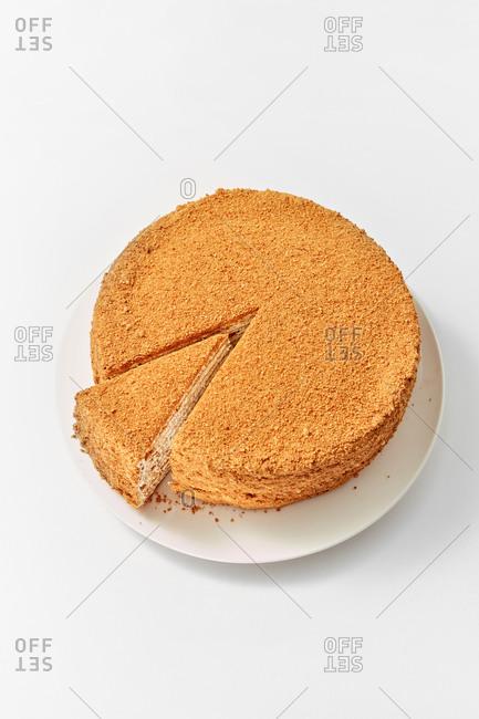 Homemade honey cake on a light grey background
