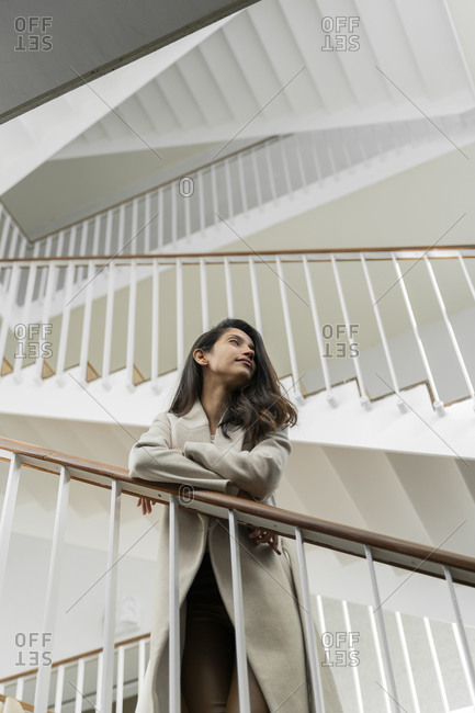 Young woman standing in staircase
