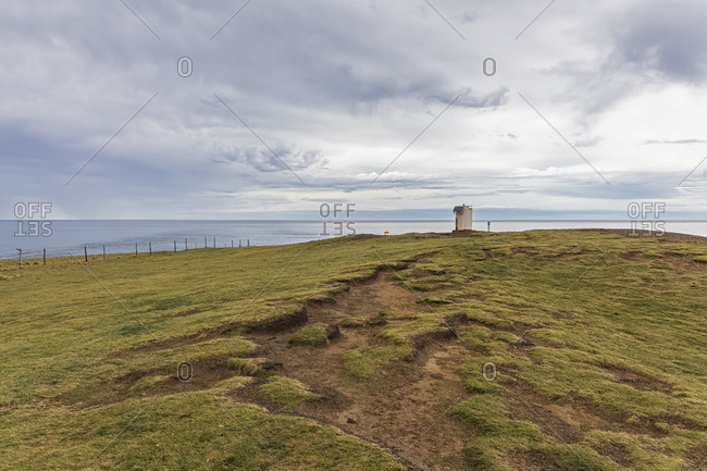New Zealand- Oceania- South Island- Southland- Slope Point- Coast on cloudy day