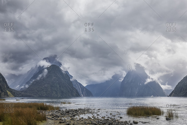 New Zealand- Oceania- South Island- Southland- Fiordland National Park- Mitre Peak and Milford Sound on cloudy day