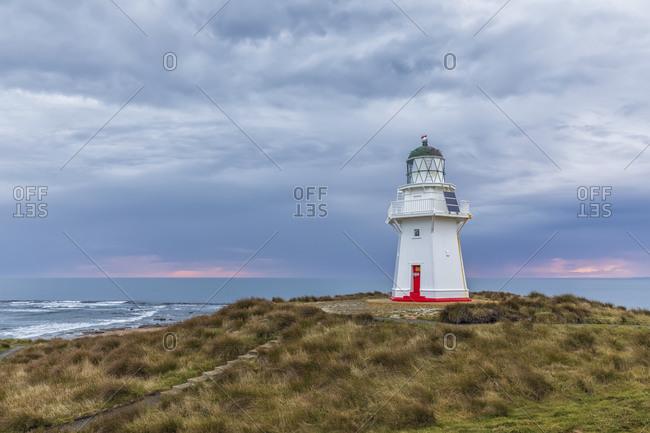 New Zealand- Oceania- South Island- Southland- Otara- Waipapa Point Lighthouse at sunset