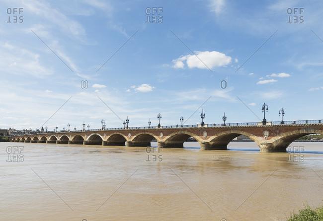 France- Gironde- Bordeaux- Sky over Pont de Pierre stretching across Garonne river