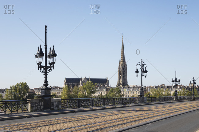 September 12, 2019: France- Gironde- Bordeaux- Clear sky over Pont de Pierre with Basilica of Saint Michael in background