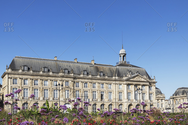 France- Gironde- Bordeaux- Clear sky over flowers blooming in front of Place de la Bourse