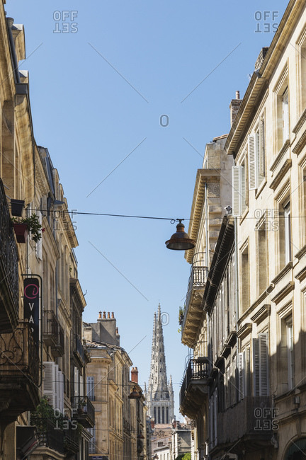 September 12, 2019: France- Gironde- Bordeaux- Old town residential buildings with Bordeaux Cathedral in background