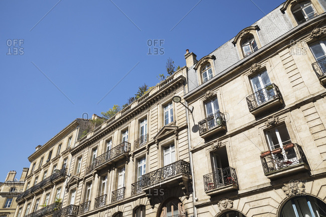 France- Gironde- Bordeaux- Low angle view of windows and balconies of old town residential buildings