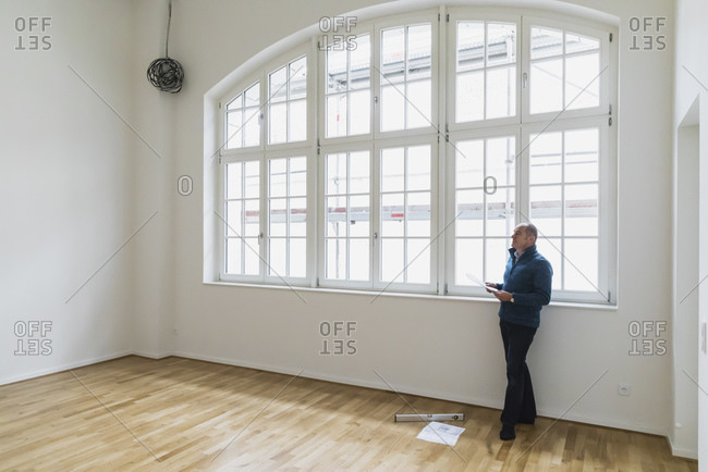 Man checking specifications of refurbished luxury loft