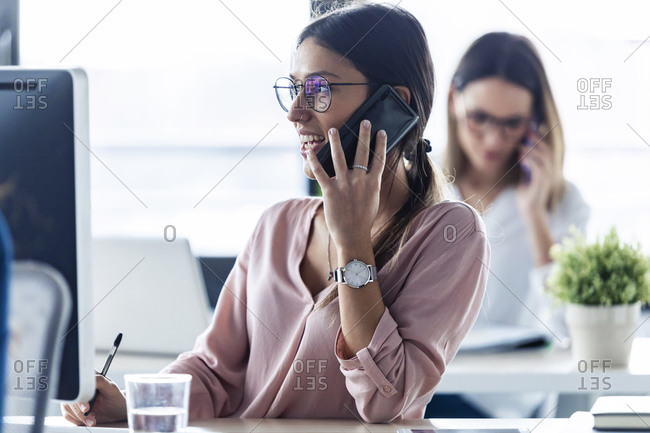 Businesswoman phoning at the office