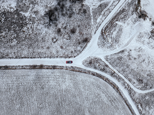 Russia- Moscow Oblast- Aerial view of car driving along country road past snow-covered fields