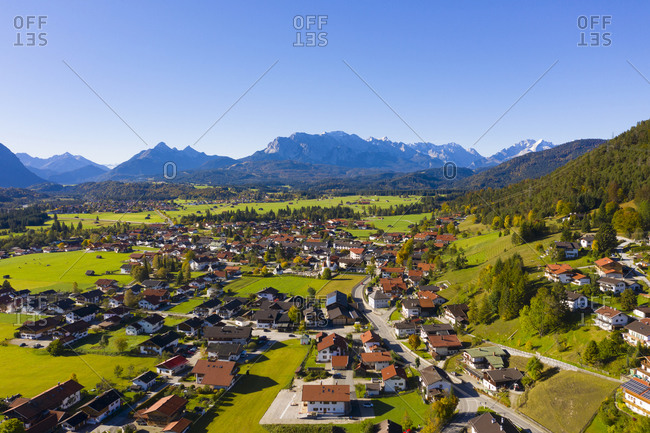 Germany- Bavaria- Upper Bavaria- Werdenfelser Land- Wallgau municipality- Aerial view of village with Wetterstein Mountains in distance