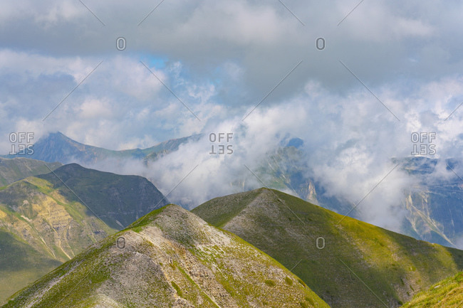 Italy- Umbria- Sibillini mountain range- Mount Vettore covered with clouds