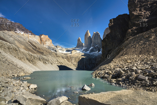 Chile- Ultima Esperanza Province- Scenic view of glacial lake with Torres del Paine in background