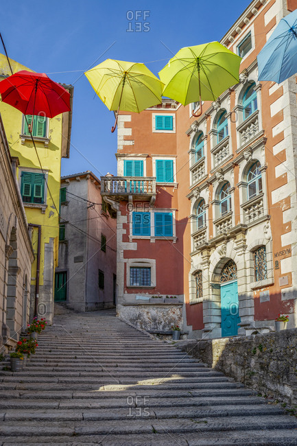 July 2, 2018: Croatia- Istria- Labin- Old town alley with colorful umbrellas