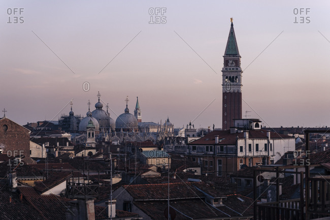 Italy- Venice- Cityscape with St. Marks basilica campanile at sunset