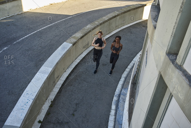 Two sportswomen jogging in the city