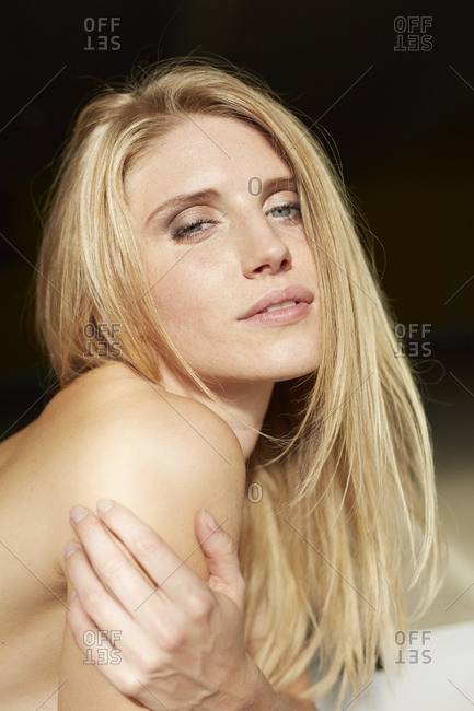 Portrait of sexy blond young woman lying down