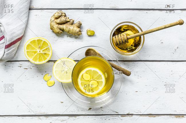 Studio shot of hot tea with ginger- lemon and honey