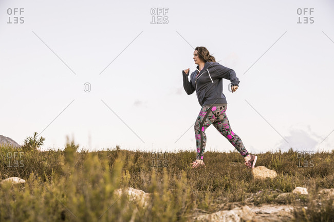 Plus-Size-Model jogging in the countryside