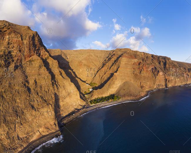 Spain- Canary Islands- La Gomera- Valle Gran Rey- Aerial view of playa de Argaga and Barranco de Argaga gorge at sunset