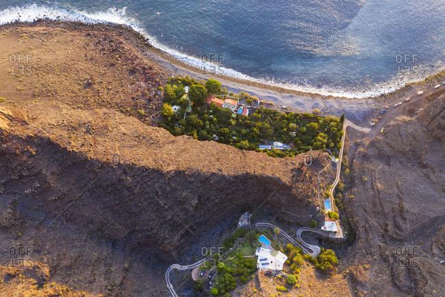 Spain- Canary Islands- La Gomera- Valle Gran Rey- Finca Argayall- Aerial view of Playa de Argaga at sunset