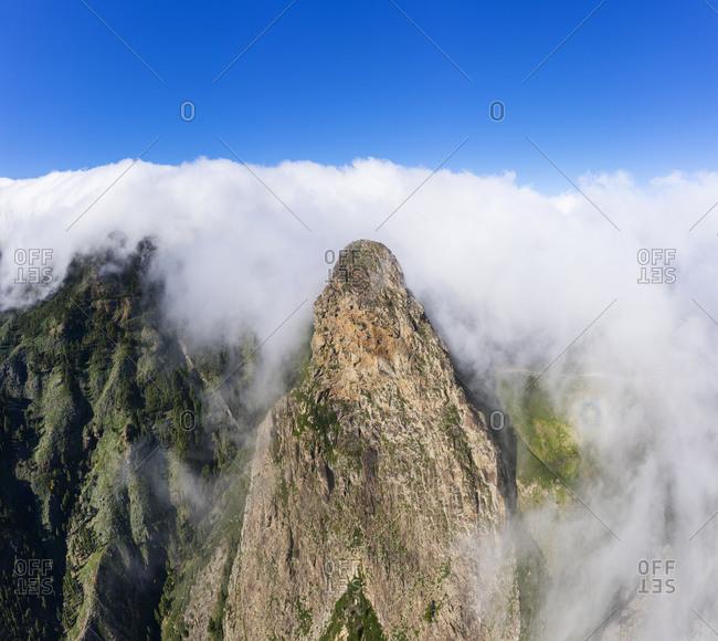 Spain- Canary Islands- La Gomera- Monumento Natural de los Roques- Aerial view of Roque de Agando covered with clouds