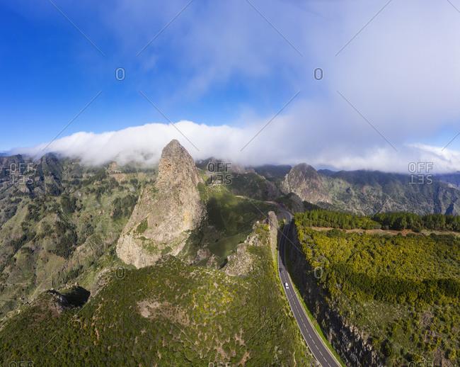 Spain- Canary Islands- La Gomera- Monumento Natural de los Roques- Aerial view of Roque de Agando and mountain road