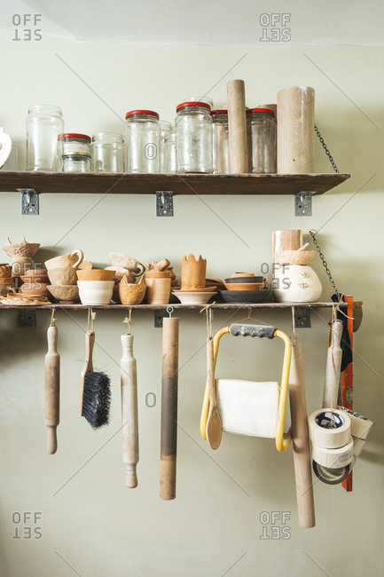 Assortment of tools on a shelf in a pottery