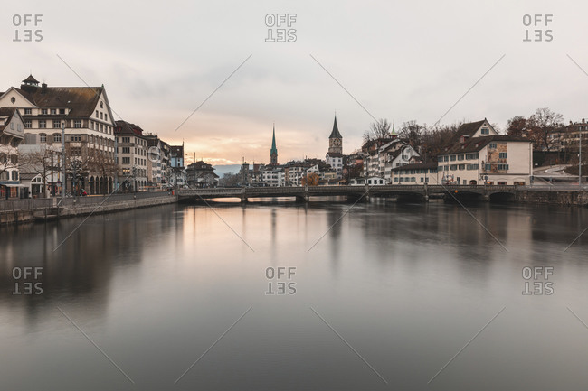 Switzerland- Zurich- City with Limmat river- houses on riverfront and bell towers in background