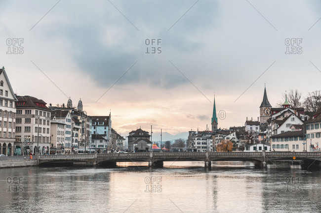 December 1, 2019: Switzerland- Zurich- City with Limmat river- houses on riverfront and bell towers in background