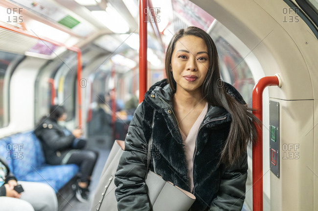 Portrait of content woman in underground train- London- UK
