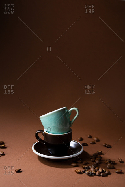 Two coffee mugs stacked on saucer