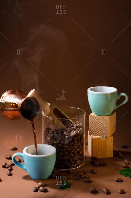 Pouring freshly brewed Turkish coffee
