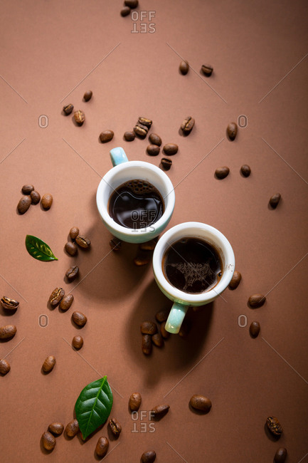 Two cups of freshly brewed coffee