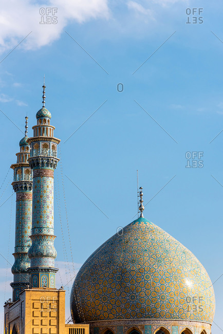 Colorfully ornamented minarets and dome at Shrine of Fatima Masuma in Qom, Iran