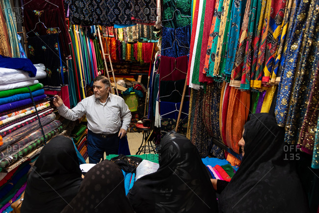 March 3, 2019: Islamic outfit seller (hijab, veils and scarfs) in bazaar. Isfahan, Iran