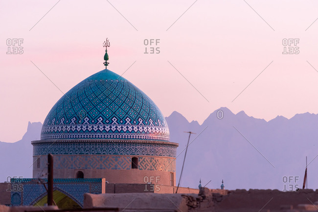 Colorfully ornamented dome in Yazd at sunset, Iran