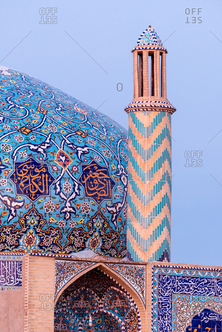 Colorfully ornamented minaret and dome in Yazd, Iran
